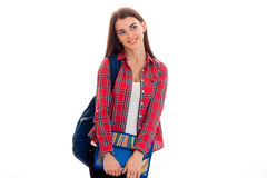 Portrait of young cheerful student girl with backpack and folders for notebooks isolated on white background Stock Images