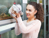 Portrait of young cheerful woman holding fluffy animal Royalty Free Stock Image