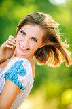 Portrait young cheerful woman peeps Royalty Free Stock Image