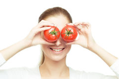Portrait of young cheerful woman with tomatoes Stock Photo