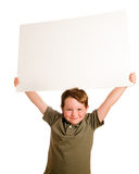 Portrait of young child boy holding blank sign Stock Image