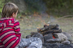 Portrait of young child boy looking at fire Stock Photos