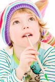 Portrait of young child painting Stock Photography