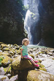 Portrait of a Young Child by Waterfall Royalty Free Stock Photos