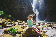Portrait of a Young Child by Waterfall Royalty Free Stock Photo