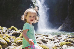 Portrait of a Young Child by Waterfall Royalty Free Stock Image
