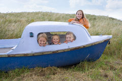 Portrait of young children in boat Stock Images