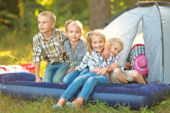 Portrait of young children on a camping stock photography