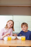 Portrait of young children having breakfast Royalty Free Stock Photo