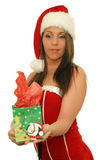 Young christmas woman giving a gift Royalty Free Stock Images