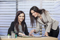 Portrait of a young colleagues working together. In the office stock photography