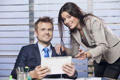 Portrait of a young colleagues working together. In the office royalty free stock photos