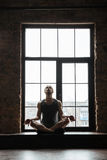 Portrait of a young concentrated sportsman meditating Royalty Free Stock Image