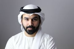 Portrait Of A Young Confident Arab Businessman Wearing UAE Emirati Tradational Dress