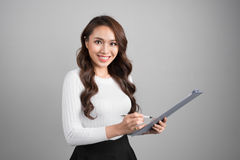 Portrait of young confident asian business woman with folder Royalty Free Stock Photos