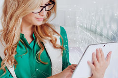 Portrait of young confident business lady, use tablet, white background Royalty Free Stock Images