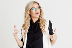 Portrait of young confident business lady, white background. Beautiful Girl Show class Sign Royalty Free Stock Images