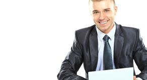 Young confident business man with laptop Royalty Free Stock Photo