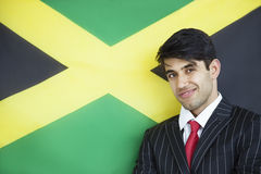 Portrait of a young confident businessman against Jamaican flag Stock Photography