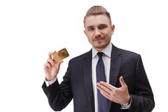Portrait of young confident bussinessman, holding gold card in his right hand. stock photos