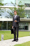 portrait of young confident caucasian businessman with cellphone Royalty Free Stock Images