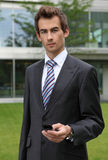 portrait of young confident caucasian businessman with cellphone Stock Photos