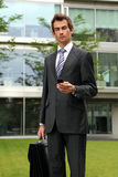 portrait of young confident caucasian businessman with cellphone Stock Images