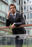 Portrait of young confident caucasian businessman talking on cellphone Royalty Free Stock Photography