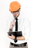 Portrait of young construction engineer in orange helmet with folder on white background Stock Photo