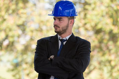 Portrait Of Young Construction Manager With Arms Crossed Stock Photo