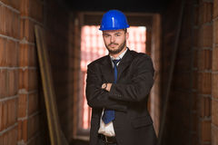 Portrait Of Young Construction Manager With Arms Crossed Stock Photos