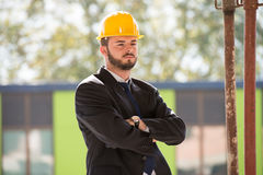 Portrait Of Young Construction Manager With Arms Crossed Royalty Free Stock Images