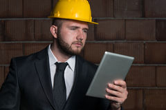 Portrait Of Young Construction Manager With Personal Computer Stock Image