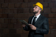 Portrait Of Young Construction Manager With Personal Computer Royalty Free Stock Images