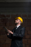 Portrait Of Young Construction Manager With Personal Computer Stock Images