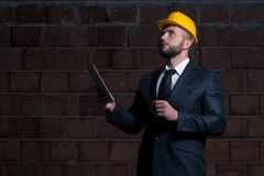 Portrait Of Young Construction Manager With Personal Computer Royalty Free Stock Image