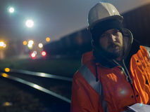 Portrait of young construction worker in helmet at night. Royalty Free Stock Photography