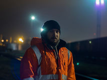Portrait of young construction worker at night. Royalty Free Stock Photos