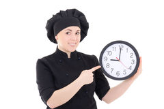 Portrait of young cook woman in black uniform with clock isolate Stock Photo