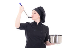 Portrait of young cook woman in black uniform holding pan and ta Royalty Free Stock Image