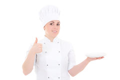 Portrait of young cook woman in uniform with empty plate thumbs Stock Image