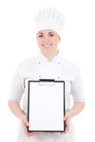 Portrait of young cook woman in uniform holding clipboard isolat Stock Photos