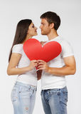 Portrait of a young couple. With red heart Royalty Free Stock Photography