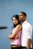 Portrait of a young couple. Mixed-race man with an asian woman standing outside Stock Photos