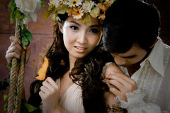 Portrait of young couple in antique dress Stock Photo