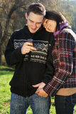 Portrait of young couple in autumn outdoo Stock Photos