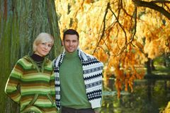 Young couple in autumn park Royalty Free Stock Photo