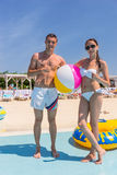 Portrait of Young Couple on Beach with Beach Ball Royalty Free Stock Photos