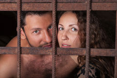 Portrait young couple behind bars Royalty Free Stock Images
