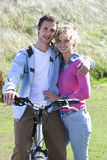 Portrait of young couple with bicycle royalty free stock images